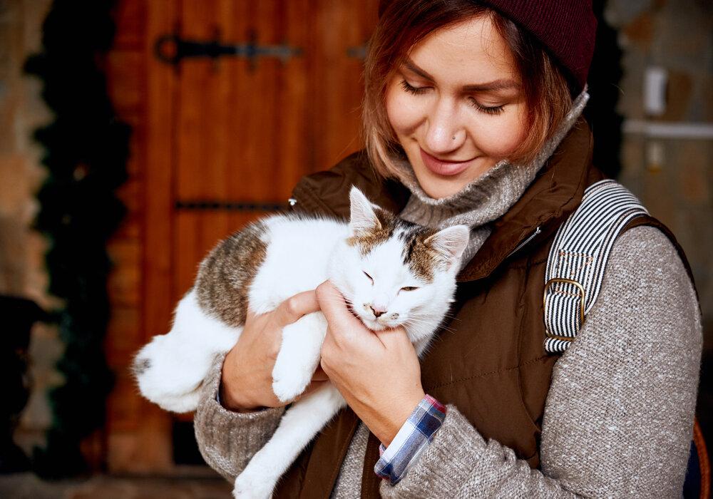 Girl adopting cat
